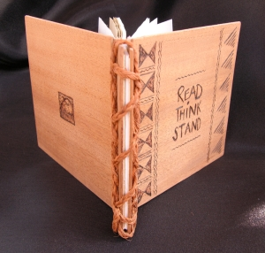 Wooden covered book with coconut sinnet binding