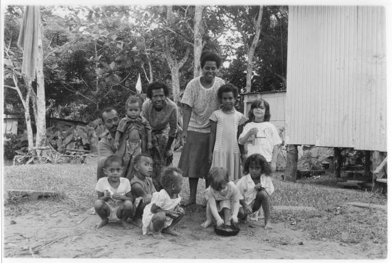 Moala Settlement family with Fulmer girls, outside Suva, Fiji